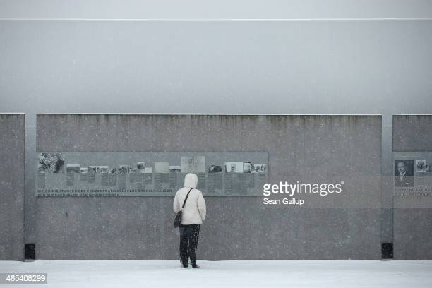 A visitor reads an exhibit plaque at the Sachsenhausen concentration camp memorial on Holocaust Memorial Day on January 27 2014 in Oranienburg...
