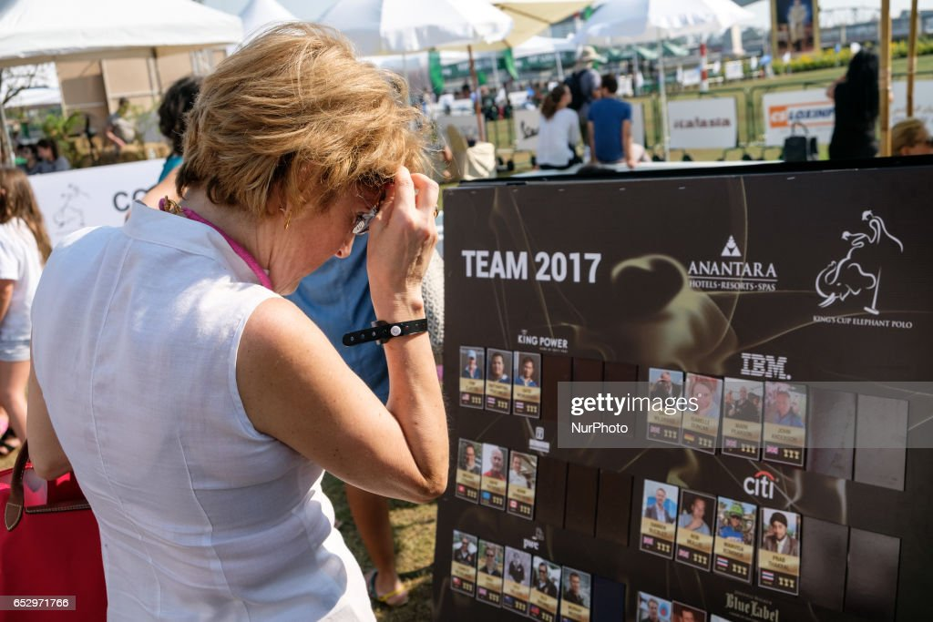 A visitor reads programm of the 2017 King's Cup Elephant Polo tournament at Anantara Chaopraya Resort in Bangkok, Thailand on March 12, 2017. The King's Cup Elephant Polo is one of the biggest annual charity events in Thailand. Since the first tournament, originally held in the seaside town of Hua Hin, 50 street elephants have been rescued. The annual event allows for a further 20 young elephants to be taken off the streets for the duration of the tournament, providing them with the best food possible, as well as the only proper veterinary check they receive all year.Elephants are a proud cultural symbol of Thailand's history.