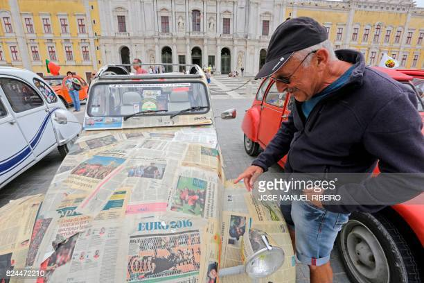 Visitor reads the papers painted on a car parked in Mafra after the arrival of the parade of Citroen classic cars 2CV during the World 2017 2CV...