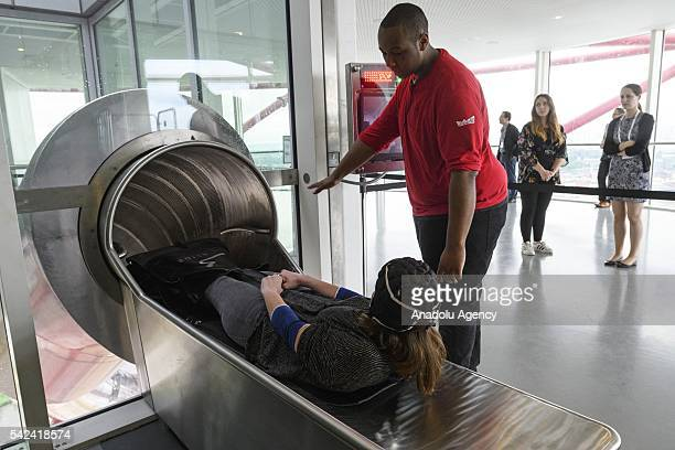 Visitor receives instructions from staff before going down at the Slide in the ArcelorMittal Orbit in London United Kingdom on June 23 2016