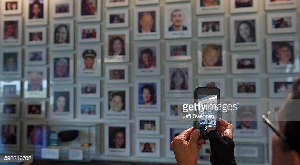 A visitor records a video of the portraits of the victims of Flight 93 at the Flight 93 National Memorial in Shanksville Pennsylvania on August 19...