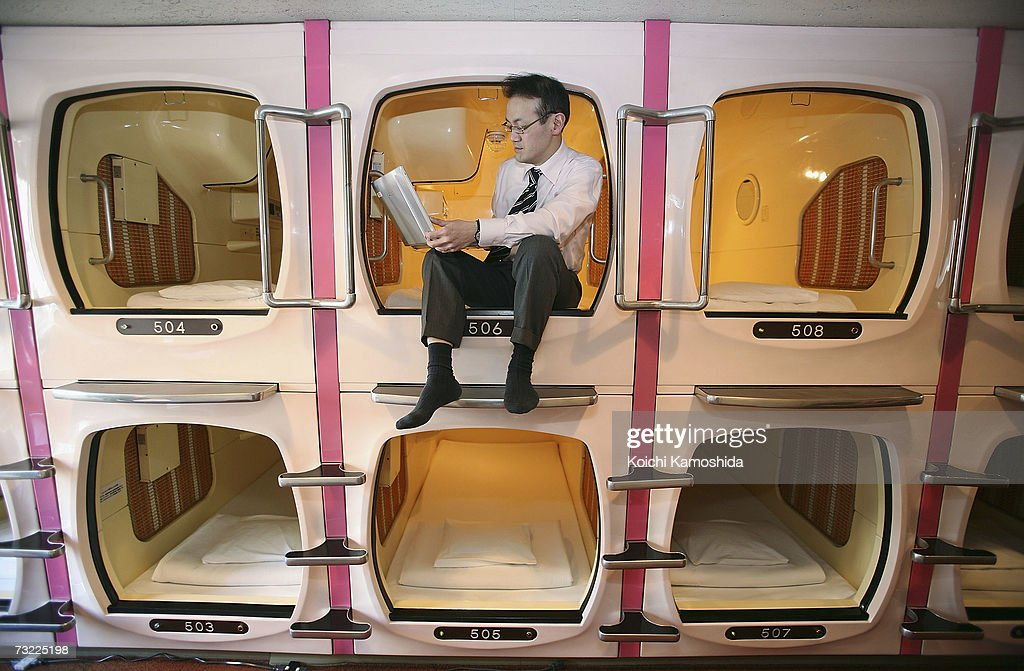 https://media.gettyimages.com/photos/visitor-relaxes-in-a-sleeping-module-at-tokyos-tube-hotel-capsule-inn-picture-id73225198