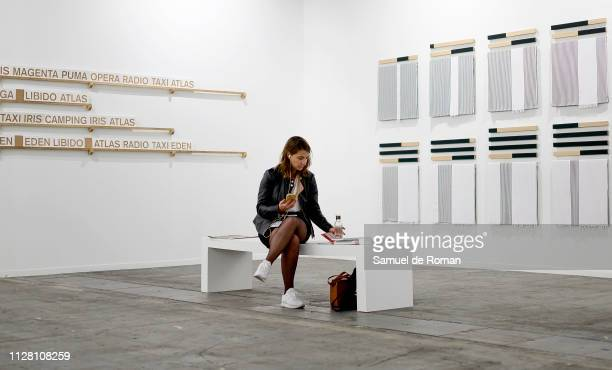 A visitor rests during the 38th International Contemporary Art Fair held in Madrid at Ifema on February 28 2019 in Madrid Spain