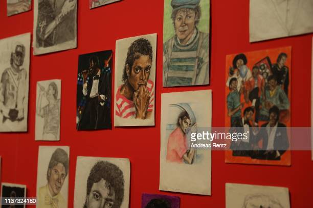 A visitor reviews drawings of Michael Jackson during the preview of the exhibition 'Michael Jackson On the Wall' at Bundeskunsthalle on March 21 2019...