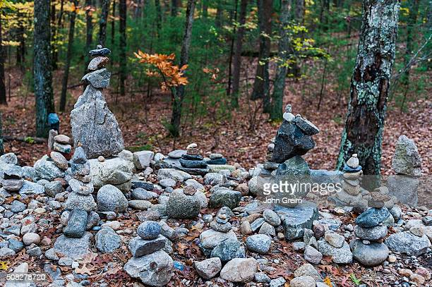 Visitor rock pile and cairns pay tribute on the site of Thoreau's cabin at Walden Pond