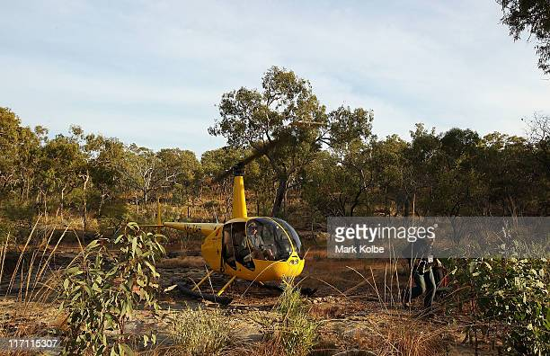 A visitor runs clear from the helicopter on a visit the Giant Horse Aboriginal rock art galleries in the Quinkan Country on June 19 2011 in Laura...