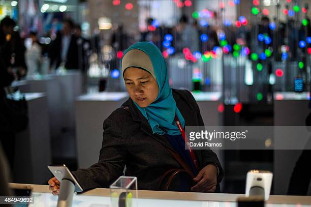 A visitor samples a HTC phone during the first day of the Mobile World Congress 2015 at the Fira Gran Via complex on March 2 2015 in Barcelona Spain...