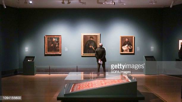A visitor seen looking at a frame during the Exhibition by Lorenzo Lotto at the National Gallery The exhibition is free for members of public from...