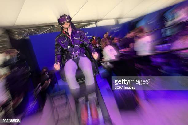 A visitor seen trying out the virtual reality goggles at the Mobile World Congress The Mobile World Congress 2018 is being hosted in Barcelona from...
