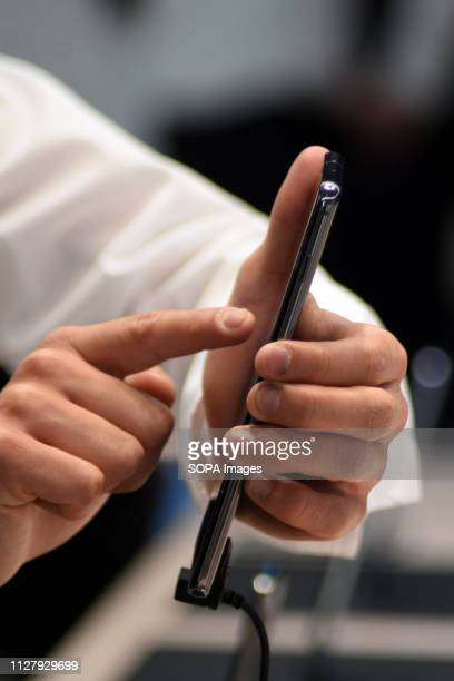 L´HOSPITALET CATALONIA SPAIN A visitor seen trying the new Samsung S10 smartphone at the Mobile World Congress 2019 in Barcelona