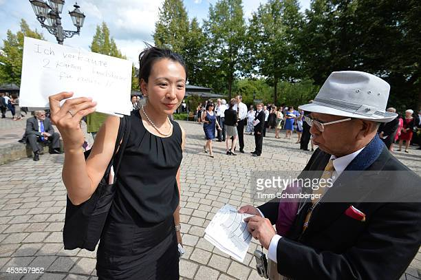 Visitor sells a ticket at Bayreuth Festival Theatre on August 12, 2014 in Bayreuth, Germany.