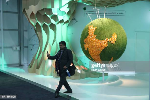 A visitor shoots a selfie in front of a climaterelated installation at the Indian pavillion in Bonn Zone at the COP 23 United Nations Climate Change...
