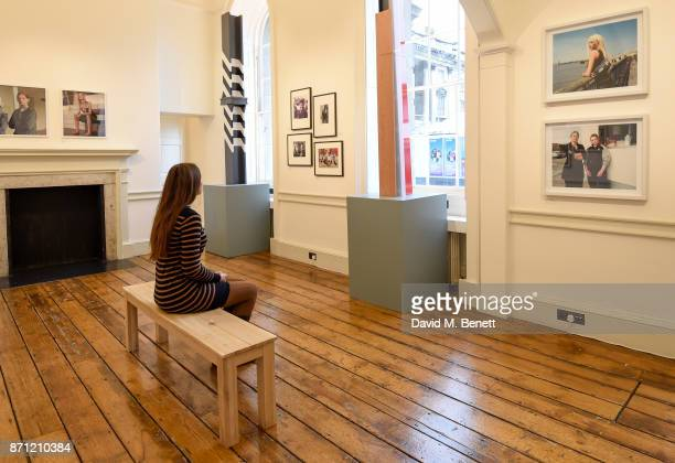A visitor sits in front of an installation entitled OffSET by designer Ben Kelly who worked on the interior design of the iconic Hacienda nightclub...