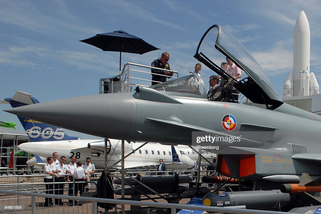A visitor sits in the cockpit of a Eurofighter Typhoon jet