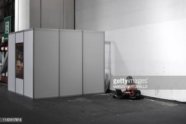 Visitor sits in the exhibiting space that was initially allocated to Italian openly neo-fascist publishing house Altaforte, which was excluded from...