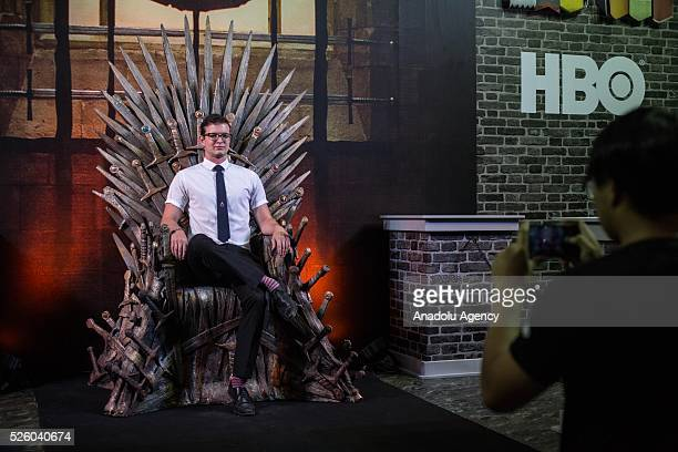 A visitor sits on the throne at the Game of Thrones area during the Bangkok Comic Con 2016 Festival at Bitec Exhibition Centre in Bangkok Thailand on...