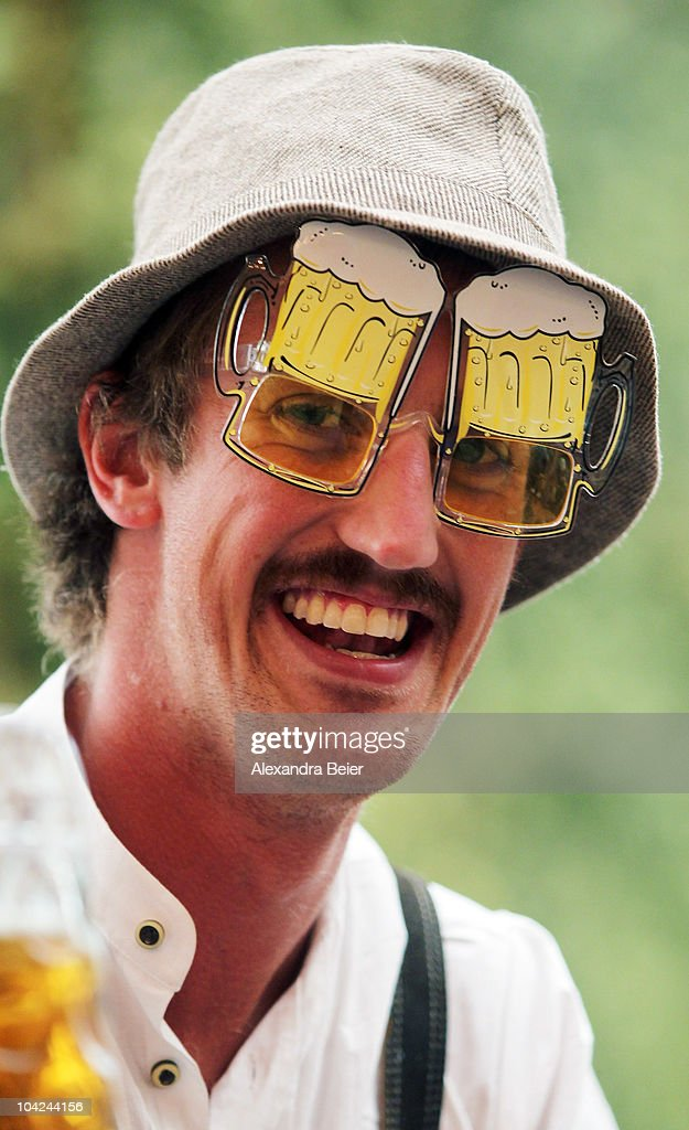 A visitor smiles as he wears beer glasses during the opening day of the Oktoberfest at Theresienwiese on September 18, 2010 in Munich, Germany. 2010 marks the 200th anniversary of Oktoberfest.The Oktoberfest tradition started in 1810 to celebrate the October 12th marriage of Bavarian Crown Prince Ludwig to the Saxon-Hildburghausen Princess Therese. The citizens of Munich were invited to join in the festivities which were held over five days on the fields in front of the city gates. The main event of the original Oktoberfest was a horse race. The world's biggest beer festival will last this year from September 18 to October 4.