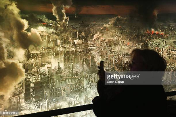 A visitor snaps a photo of a 360 degree panorama display by artist Yadegar Asisi that depicts the city of Dresden in the aftermath of the February 13...