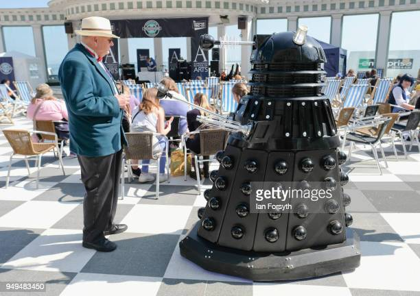 Visitor speaks with a Dalek during the Scarborough Sci-Fi event held at the seafront Spa Complex on April 21, 2018 in Scarborough, England. The North...
