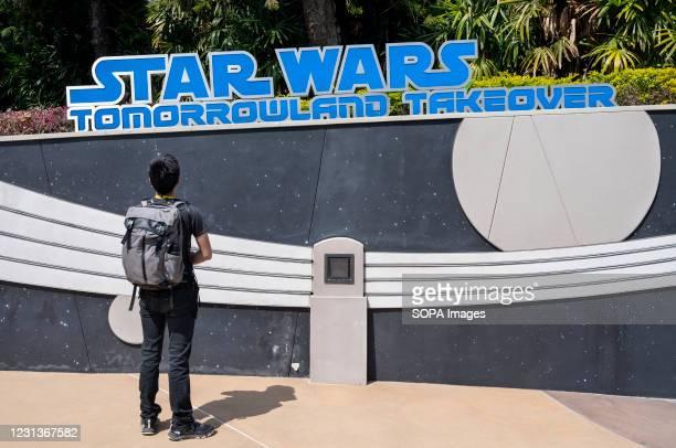 Visitor stands at the entrance of Disney's Star Wars attraction at Disneyland Resort amusement park in Hong Kong.