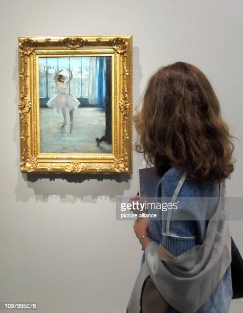 "Visitor stands before the painting ""Dancer in the artists studio"" of Edgar Degas in the exhibition ""Icons of Modern Art - The Shchukin Collection"" in..."
