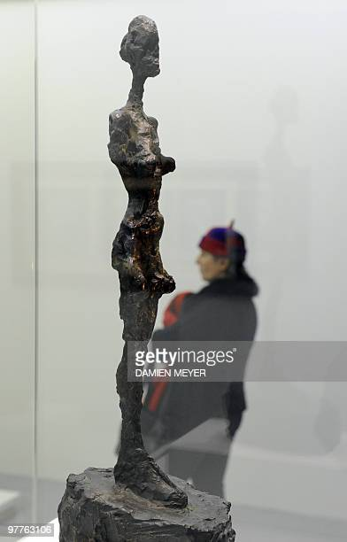 """Visitor stands by """"Femme Bras Tronqués"""", a sculpture by Swiss artist Alberto Giacometti during the exhibition """"Goya e il mondo moderno"""" on March 16,..."""