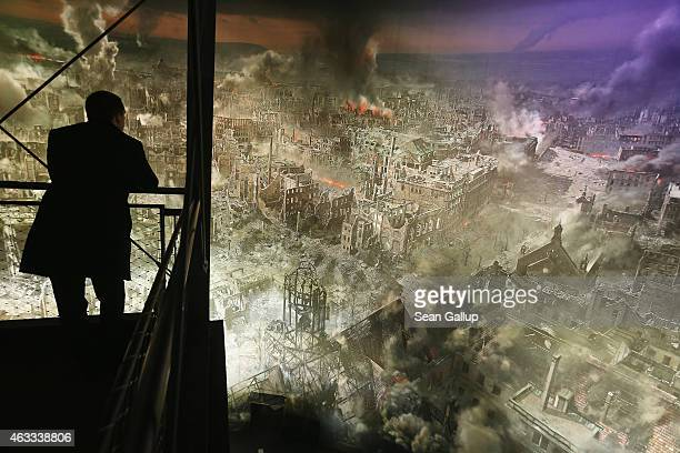 A visitor stands in front of a 360 degree panorama display by artist Yadegar Asisi that depicts the city of Dresden in the aftermath of the February...