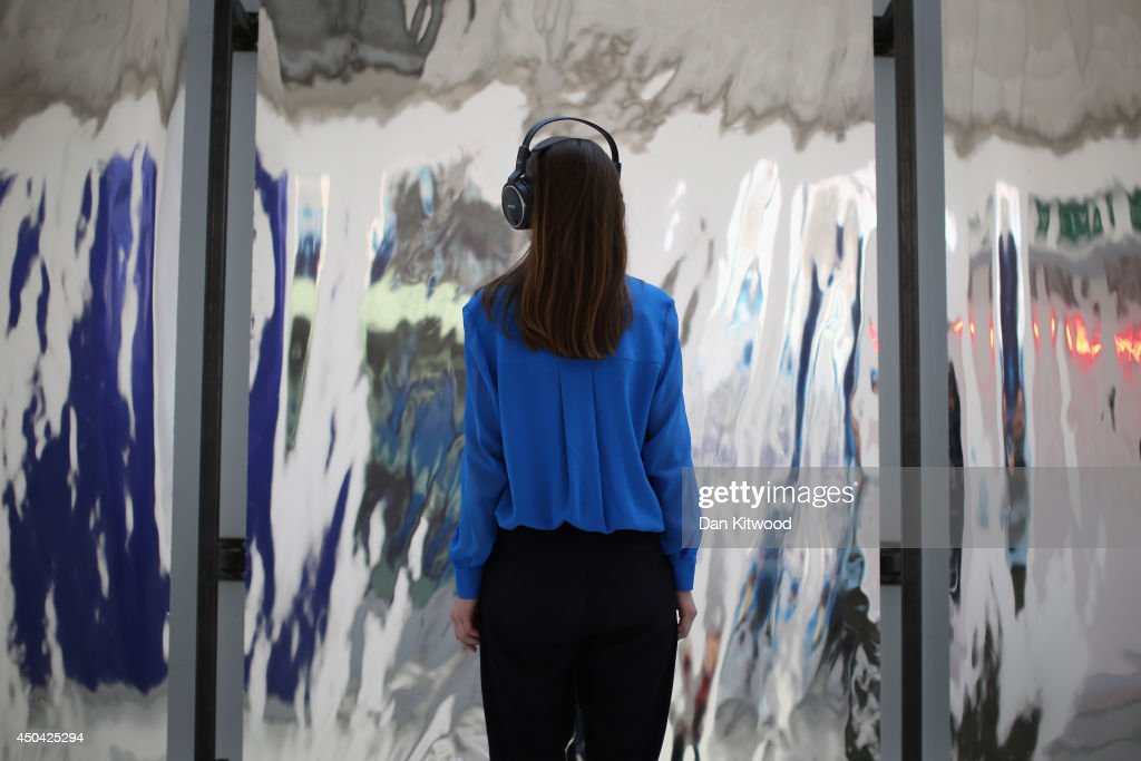 A visitor stands in front of a piece of work by final year student Hannah Perry entitled 'Feeling It' on June 11, 2014 in London, England. The piece makes up part of the the annual 'RA Schools Show', which brings together work by final year students, and is currently running at the RA until June 29, 2014.