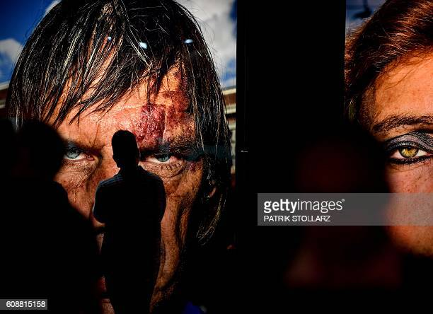 A visitor stands in front of a portrait taken by artist Bruce Gilden at the Masters of Photography exhibition at the Photokina trade fair in Cologne...
