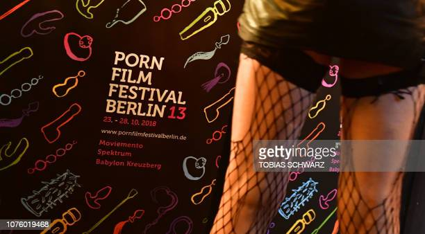 A visitor stands in front of a poster announcing the Porn Film Festival in Berlin at the Moviemento cinema on October 25 2018 Ethical diverse and not...