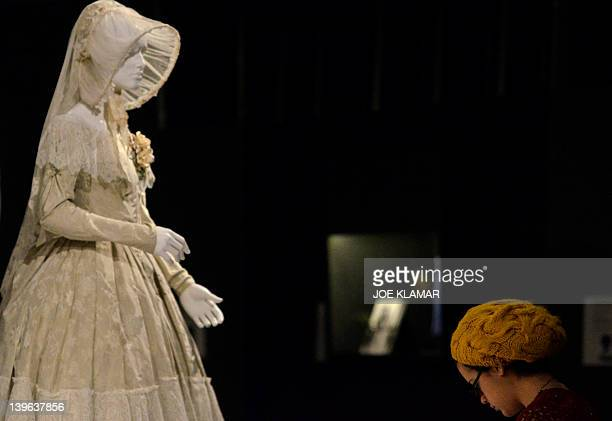 A visitor stands in front of the creation of 2012 Academy nominee Jane Eyre designed by Michael O'Connor at at the FIDM Museum during the twentieth...