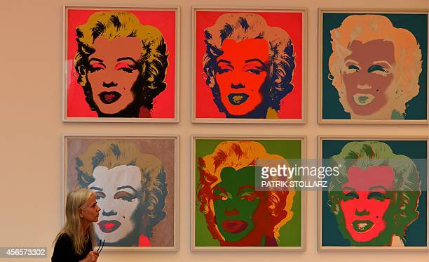 A visitor stands in front of the painting 'Marylin' from American artist Andy Warhol during the exhibition 'LUDWIG GOES POP' at the Museum Ludwig in...