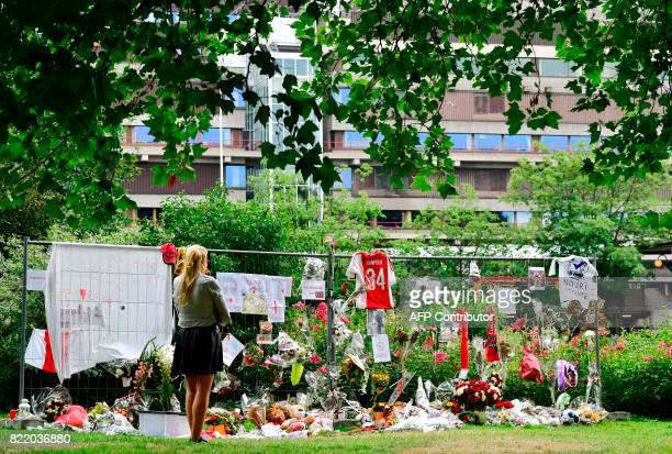 A Visitor stands in silence next to items placed by the hospital where the Ajax midfielder Abdelhak Nouri receives treatments in Amsterdam on July 22...
