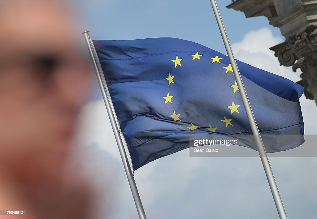 A visitor stands near a flag of the European Union at the Reichstag the day after a majority of people voted 'no' in the Greek referendum on July 6, 2015 in Berlin, Germany. Greeks voted in a strong majority against the reform plan proposed by the troika of the European Central Bank, the International Monetary Fund and the European Commission in a move that many fear will lead to a departure by Greece from the Eurozone.