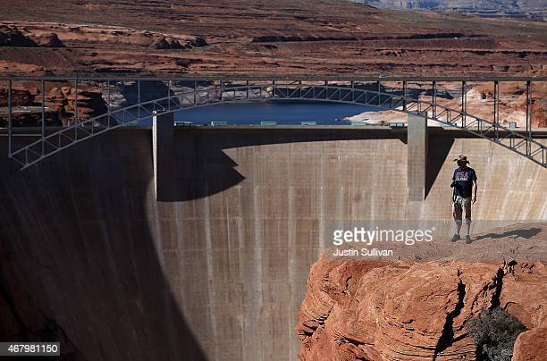 A visitor stands near the Glen Canyon Dam at Lake Powell on March 28 2015 in Page Arizona As severe drought grips parts of the Western United States...