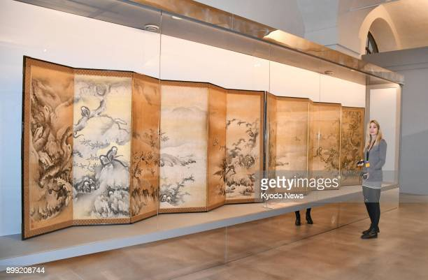 A visitor stands next to a Japanese folding screen or 'byobu' at the Uffizi Gallery in Florence Italy on Dec 4 2017 ==Kyodo