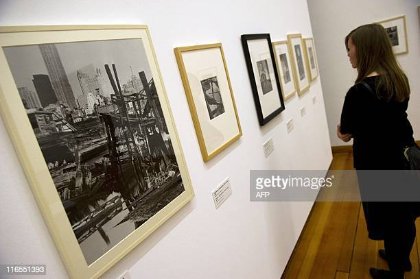 A visitor stands next to Hungarianborn US photographer Andre Kertesz' Weehawken New Jersey c 1941 at the Kertesz retrospective at Berlin's...