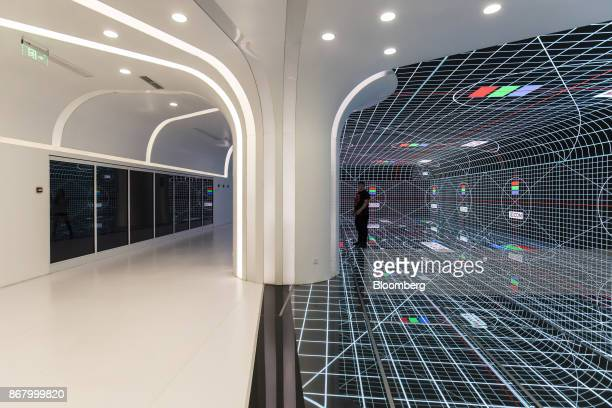 A visitor stands on a digital screen at a showroom inside the JDcom Inc headquarters in Beijing China on Monday Oct 23 2017 JDcom isChina's...