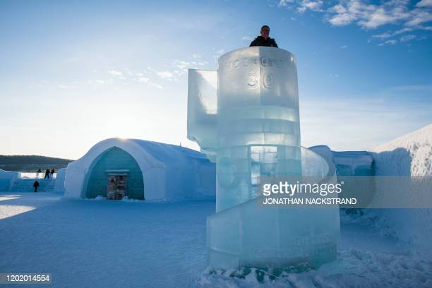 Visitor stands on an ice tower on the grounds of the Ice Hotel in the village of Jukkasjarvi, near Kiruna, in Swedish Lapland on February 9, 2020. -...