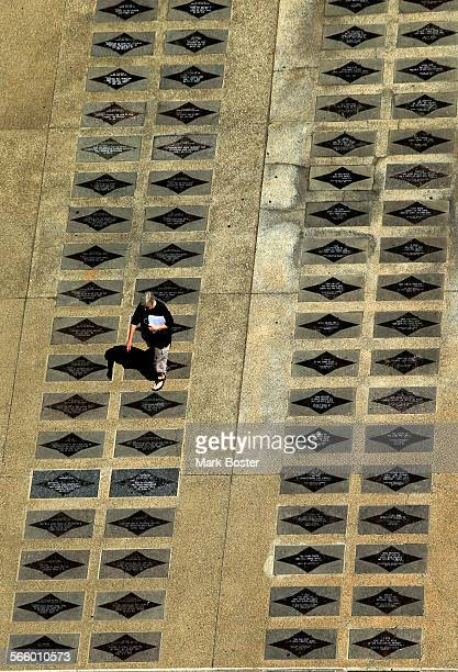 """Visitor strolls the """"Walk Of Faith"""" on the grounds of the former Crystal Cathedral in Garden Grove July 25, 2013. Sold in 2011 to the Roman Catholic..."""