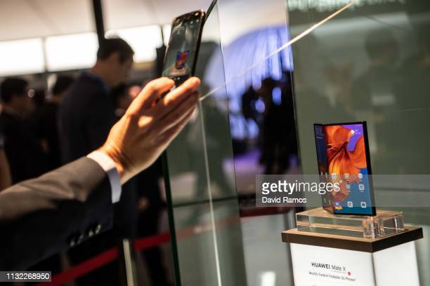 A visitor take a picture to new Huawei Mate X at the Huawei booth on day 2 of the GSMA Mobile World Congress 2019 on February 26 2019 in Barcelona...