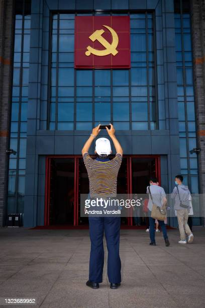 Visitor take photos of the entrance of the Nanhu Revolutionary Memorial Hall on June 15 at Nanhu Lake, Jiaxing, Zhejiang Province, China, where the...
