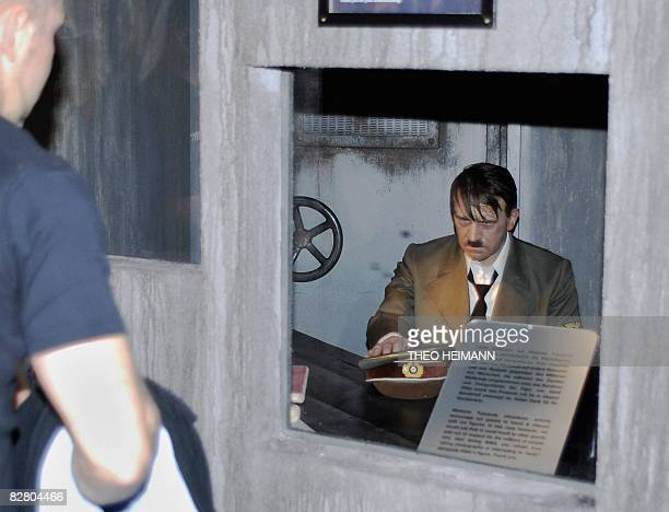 A visitor takes a look at the waxwork statue of Adolf Hitler at Madame Tussauds waxworks museum in Berlin on September 13 2008 as it returend to the...