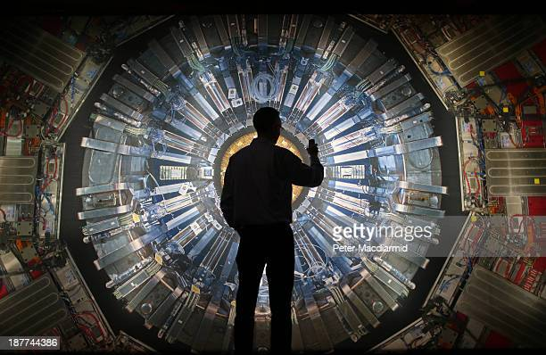 Visitor takes a phone photograph of a large back lit image of the Large Hadron Collider at the Science Museum's 'Collider' exhibition on November 12,...
