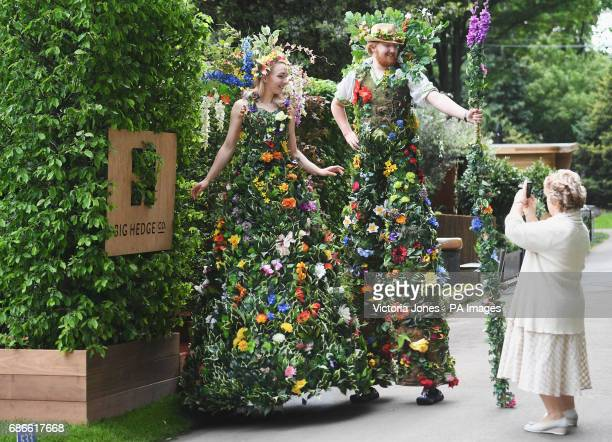 A visitor takes a photo during the press preview at the RHS Chelsea Flower Show at the Royal Hospital Chelsea London
