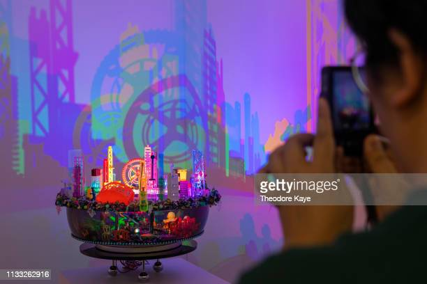 A visitor takes a photo of a sculpture by Angela Yuen at Art Central art fair on March 28 2019 in Hong Kong Hong Kong