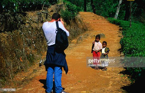 A visitor takes a photo of small children from the area near Adams Peak,  Adams Peak is Sri Lanka's most sacred seven kilometre high mountain and the place where Adam supposedly first set foot on Earth after his expulsion from heaven