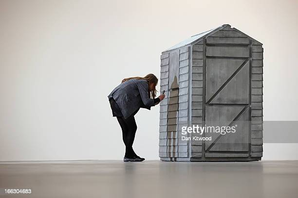 A visitor takes a photograph of a piece of work from Turner Prize winning British artist Rachel Whiteread's new show 'Detached' on April 11 2013 in...