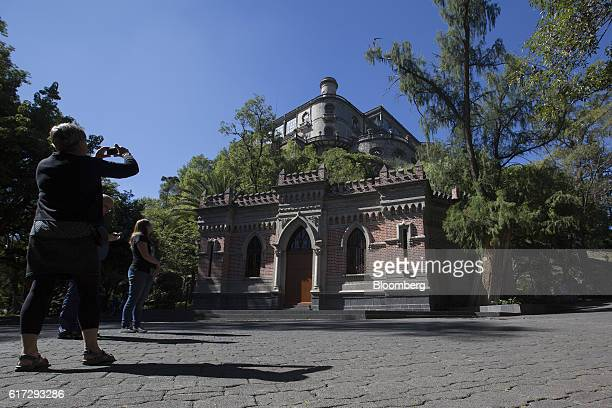 A visitor takes a photograph of the Chapultepec Castle which houses Mexico's National Museum of History inside the first section of Chapultepec Park...