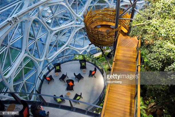 A visitor takes a photograph of the meeting area called 'The Nest' inside the Amazoncom Inc the Spheres during opening day ceremonies at the...